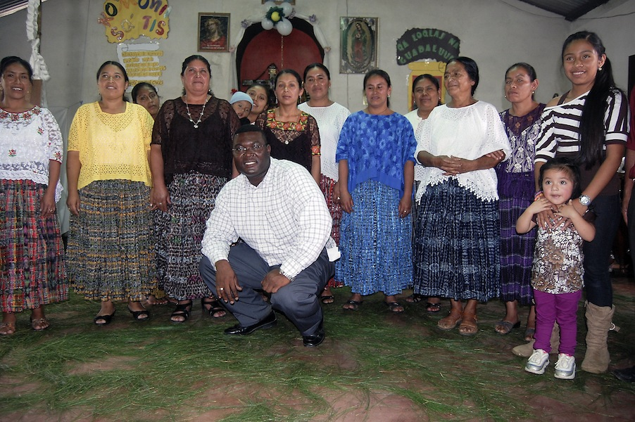missionary-priest-smiles-with-parishioners-in-Guatemala
